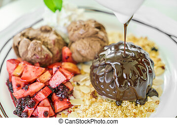 Chocolate cake with fruit peach, black currant, blueberry, apple, ice cream
