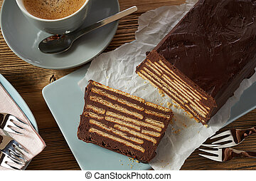 Chocolate cake with layers of biscuits