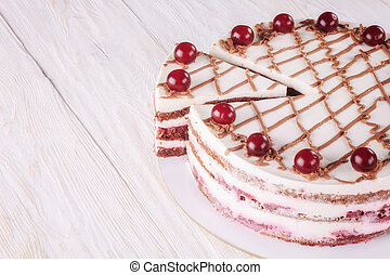 Chocolate cake with mousse, decorated cherries