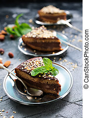 chocolate cake with nuts on the plate