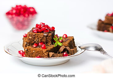 Chocolate cake with pomegranate on a plate