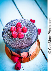 Chocolate Cake With Raspberries On Wooden Background