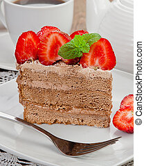 Chocolate cake with strawberries on a table
