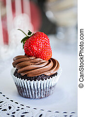 Chocolate cake with strawberries on the table