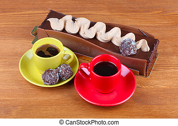 chocolate cake with two cup of coffee and chocolate balls