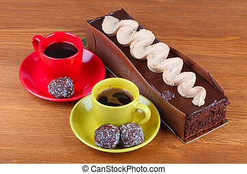 chocolate cake with two cup of coffee