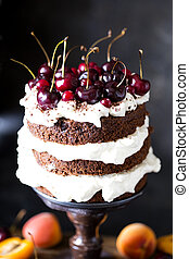Chocolate cake with whipped cream and cherries
