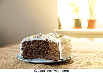 Chocolate cake with white cream cover