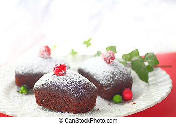 Chocolate cakes with Christmas ornaments