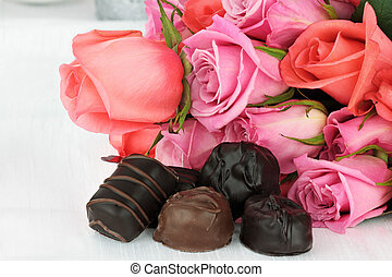 Chocolate Candies and Bouquet of Roses