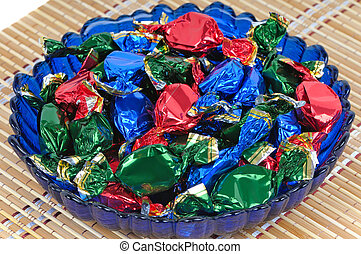 Chocolate candies in a glass blue dish