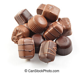 chocolate candy - a stack of chocolate candies on white ...