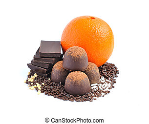 Chocolate candy, chocolate and orange on a white background