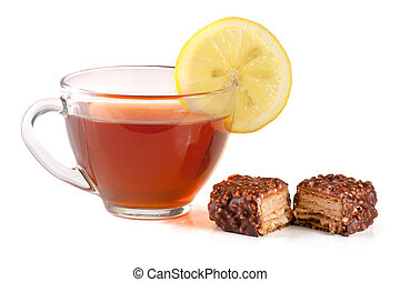 chocolate candy with a cup of tea isolated on white background.