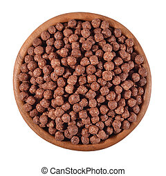 Chocolate cereal balls in a wooden bowl on a white