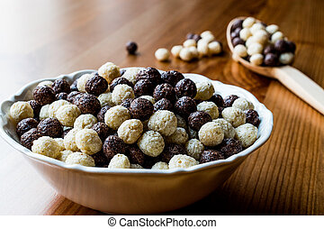 Chocolate Cereal balls in bowl with wooden spoon
