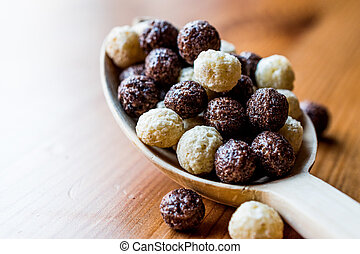 Chocolate Cereal balls in wooden spoon