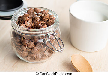 chocolate cereal cornflakes and milk for breafast