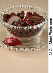 Chocolate cereals with apple