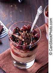 Chocolate cheese desert with cherries