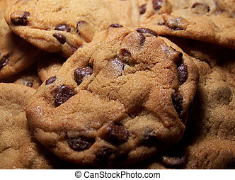 Close up color photo of fresh hot chocolate chip cookies.