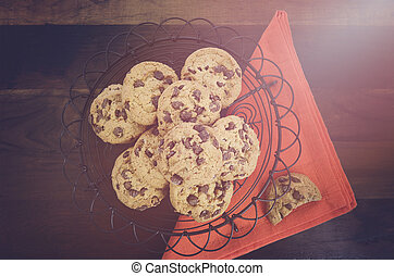 Chocolate Chip Cookies on Dark Wood Background.