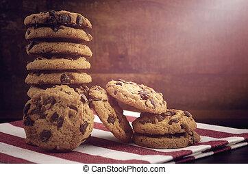Chocolate Chip Cookies on Dark Wood Background.