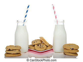 Chocolate chip cookies with bottles of milk