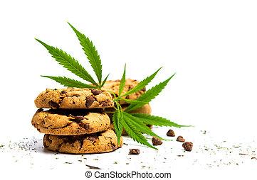 Chocolate chip cookies with marijuana isolated on white
