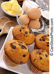 Chocolate chip muffins with ingredients