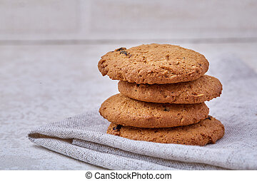 Chocolate chips cookies isolated on light background, macro, close-up, shallow depth of field, selective focus
