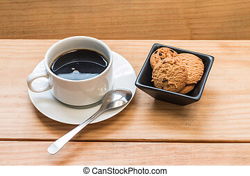 Chocolate chips cookies with white cup of coffee 2