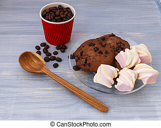 Chocolate cookies sticks with marshmallows on blue background