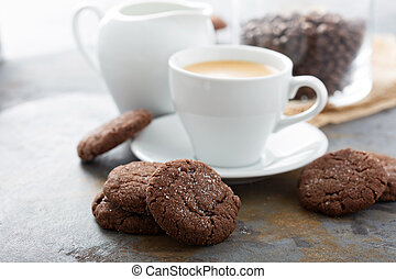 Chocolate cookies with a cup of coffee