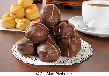 Chocolate covered cream puffs