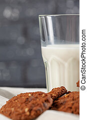 Chocolate crispy cookies with glass of milk close up