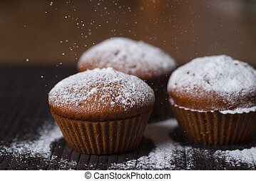 Chocolate cup cakes with powdered sugar