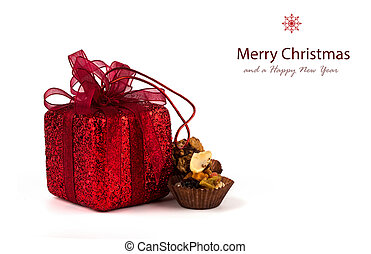 Chocolate cupcake and gifts in boxes on a white background