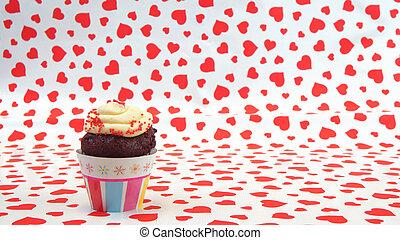 chocolate, cupcake, con, crema, en, rojo, corazones, plano de fondo