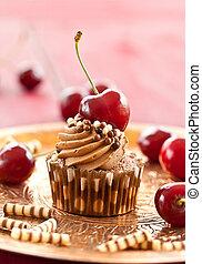 Chocolate cupcake with cherries