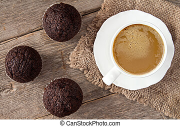 Chocolate cupcakes and cup of cappuchino