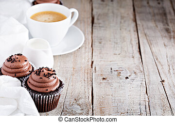 Chocolate cupcakes with a cup of coffee