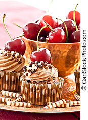 Chocolate cupcakes with cherries