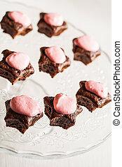 Chocolate cupcakes with pink stars-cream celebratory glass stand.
