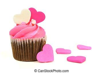 chocolate, día de valentines, cupcake, con, rosa, capa de azúcar glaseado, y, corazones
