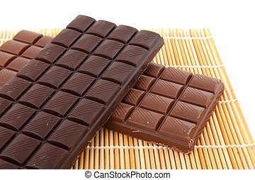 Chocolate - Dark and light chocolate on natural bamboo