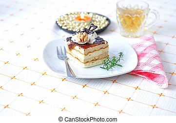 Chocolate dessert with tea and napkin