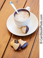 Chocolate dipped heart shaped cookies and coffee