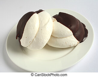 Chocolate-dipped meringue cases - Two chocolate-dipped...