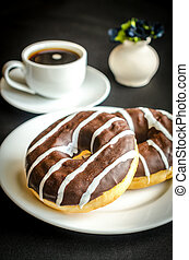 Chocolate donuts with a cup of coffee